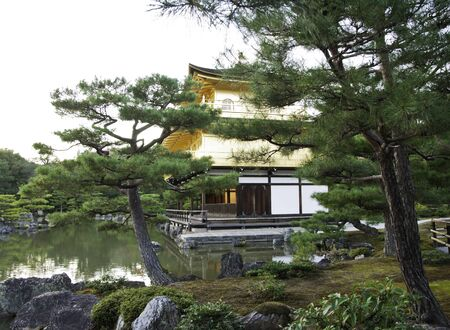 completely: Kinkakuji (Golden Pavilion) is a Zen temple in northern Kyoto whose top two floors are completely covered in gold leaf.