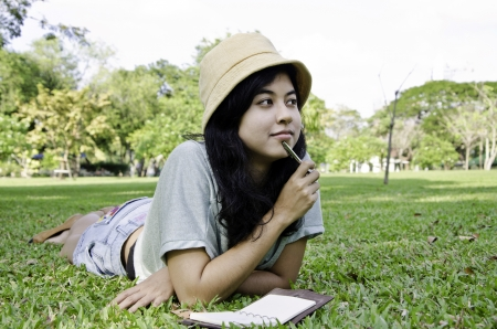 Woman thinking hard studying outside  Beautiful mixed asian   caucasian woman   photo