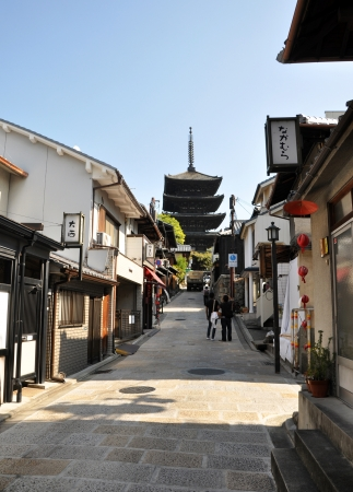KYOTO, JAPAN - OCT 21 2012: Tourists walk on a street leading to Kiyomizu Temple on October 21 2012. Kiyomizu is a famous temple in Kyoto built in year 778.