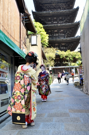 KYOTO, JAPAN - OCT 21 2012: Japanese ladies in traditional dress  on a street leading to Kiyomizu Temple on October 21 2012. Kiyomizu is a famous temple in Kyoto built in year 778.
