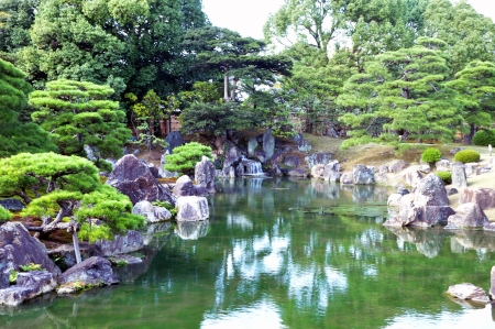 Garden with pond in japanese style at Nijo castle, Kyoto, Japan