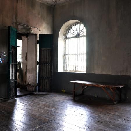 abandoned: Abandoned empty room with door, window and bench