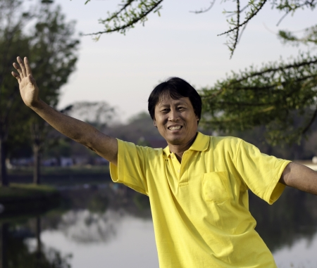 portrait of a happy asian man in summer park  Stock Photo - 18261203