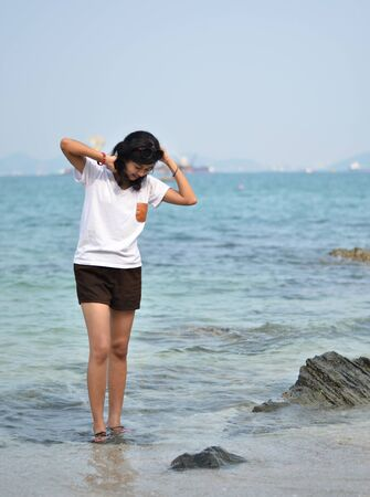 Beautiful young asian woman on beach summer holiday photo