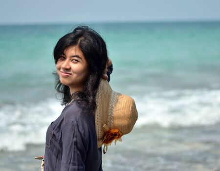 Portrait of beautiful young asian woman on beach  photo