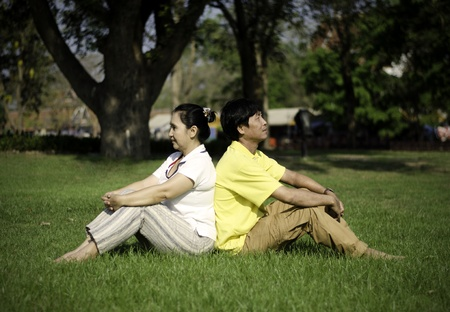 Portrait of beautiful couple sitting on ground in park relaxing Stock Photo - 18809954