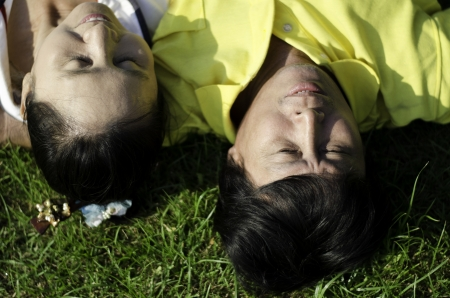 Seniors couple lying on grass outdoor Stock Photo - 18809953