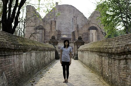 Asian woman enjoying at Wat Maheyong, Buddhist temple in Ayutthaya province, Thailand.  photo