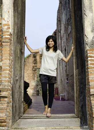Asian woman enjoying at Buddhist temple in Ayutthaya, Thailand.  photo