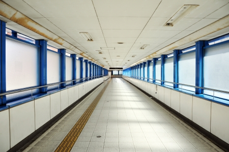 Empty long corridor in the modern office building   Stock Photo
