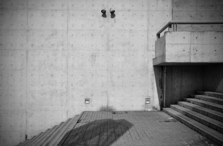 Bare concrete architecture with staircase photo