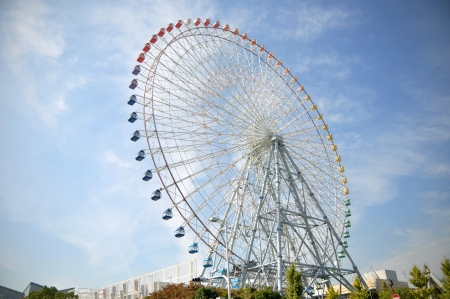 Ferris Wheel near Tempozan Habor village - Osaka City in Japan photo