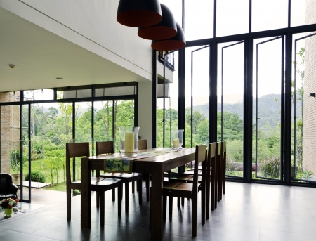 Dining room interior with wooden table and chairs in modern house