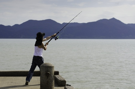 Fisherman fishing trolling in the sea, Chonburi, Thailand photo