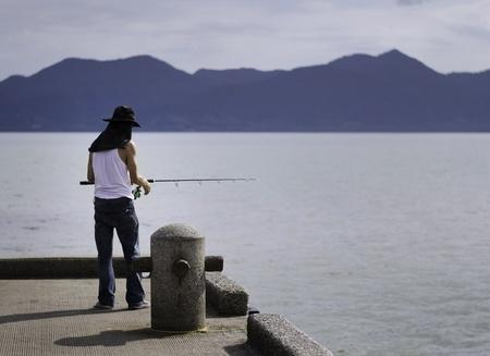 trolling: Pescador de la pesca de arrastre en el mar, Chonburi, Tailandia