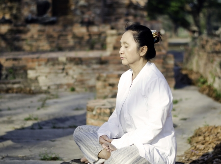 Asian woman meditating yoga in ancient buddhist temple  Stock Photo - 19804822