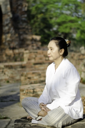 Asian woman meditating yoga in ancient buddhist temple  Stock Photo - 19804828