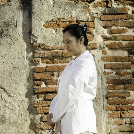 Buddhist woman standing meditating against ancient temple Stock Photo - 19804826