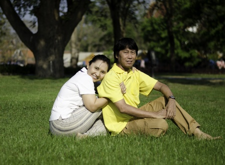 Portrait of beautiful senior couple in park, outdoor photo