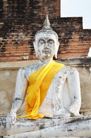 Ancient Buddha statues at Wat Yai Chai Mongkol in Ayutthaya, Thailand  photo