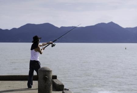 Fisherman fishing trolling in the sea, Chonburi, Thailand photo