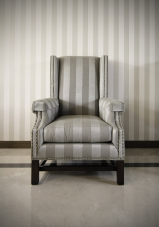luxurious armchair with striped wallpaper background photo