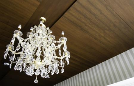 beautiful crystal chandelier hang on wood ceiling photo