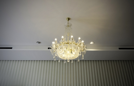 beautiful crystal chandelier in a vintage room  photo