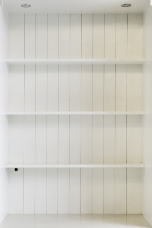 Empty white wooden shelf