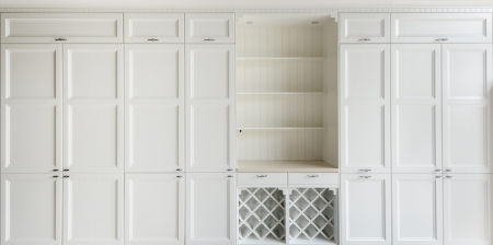 White vintage cupboard with shelf photo