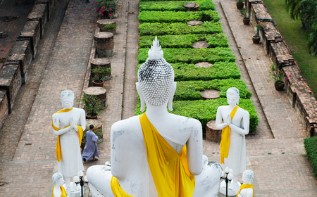 Back of Big Buddha at Old Temple Wat Yai Chai Mongkhon of Ayuthaya Province Thailand photo