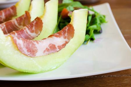 Italian appetizer, Coppa ham with melon photo