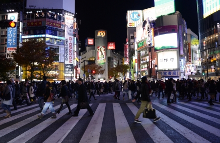 TOKYO - NOVEMBER 28  Pedestrians at the famed crossing of Shibuya district November 28, 2013 in Tokyo, JP  Shibuya is a fashion center and nightlife area