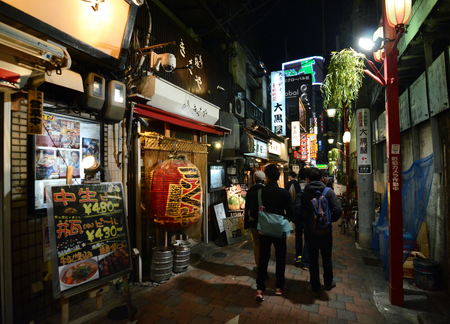 TOKYO,JAPAN - NOVEMBER 23  Narrow pedestrian street known as Yakatori alley Omoide Yokocho  in the old Shinjuku district in Tokyo, Japan on the night of November 23, 2013  A few traditional restaurants are located here