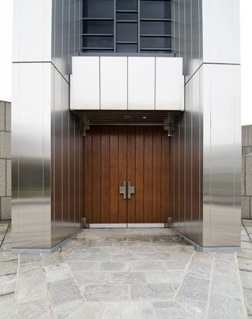 Old wood door of modern building photo