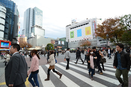 TOKYO - NOVEMBER 28  Crowds of people crossing the center of Shibuya in November 28 2013, the most important commercial center in Tokyo, Japan  Editorial