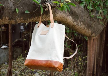 pochette: Fashion Leather Bags  hang on banyan branch