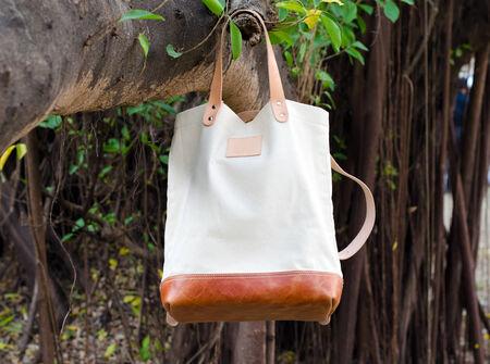 pochette: Fashion Canvas Bags hang on banyan branch Stock Photo