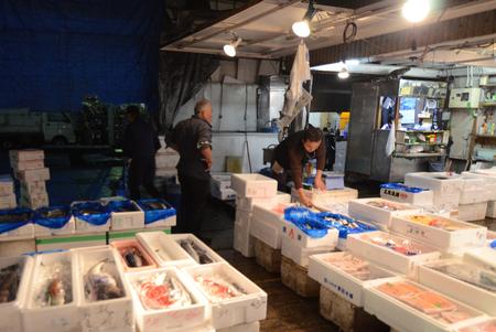 TOKYO - NOV 26  Seafood vendors at the Tsukiji Wholesale Seafood and Fish Market in Tokyo Japan on November 26, 2013  Tsukiji Market is the biggest wholesale fish and seafood market in the world