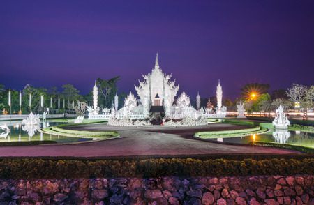 Twilight at White temple or Wat Rong Khun in twilight in Chiangrai, Thailand  photo