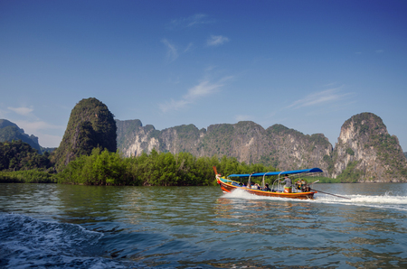 Amazing scenery of National Park in Phang Nga Bay with tourist boat, Thailand  photo