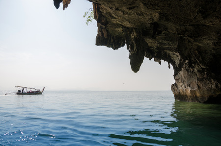National Park in Phang Nga Bay with tourist boat, Thailand  photo