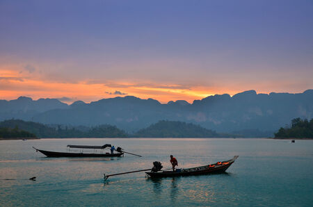 Traditional thai long tail boats at sunset ,thailand  photo