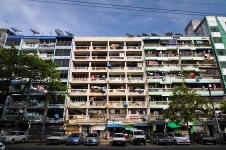 YANGON, MYANMAR - OCTOBER 12, 2013 - Facade of run-down housing block in the Indian quarter on November 12, 2013 in Yangon  The Indian quarter of Yangon is an especially poor area west of the center