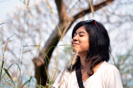 Young asian woman breathing fresh air in garden photo