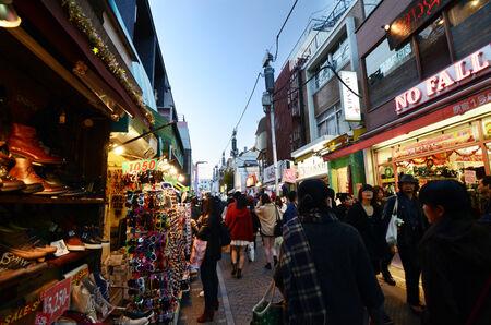 harajuku: TOKYO, JAPAN - NOVEMBER 24   Crowd at Takeshita street Harajuku on November 24, 2013 in Tokyo, Japan  Takeshita street is a street lined with fashion, cafes and restaurants in Harajuku