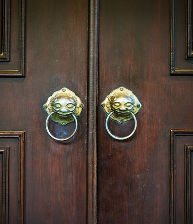 Wooden chinese door with a lion head   photo