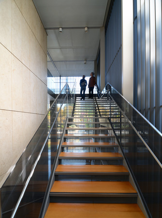 Modern metel stairs with wooden staircase in Building