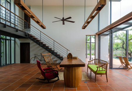transport interior: Stylish house interior, Living room with staircase Editorial
