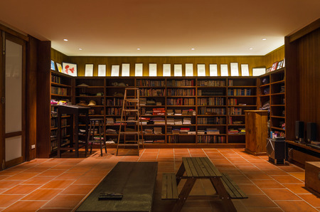Interior of studying room with wooden chair, table and ladder 에디토리얼